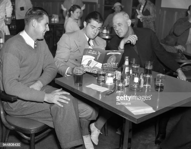 Henry Picard and Lawson Little well known tournament golfers chat with Grantland Rice prominent sports writer over refreshments during the final...