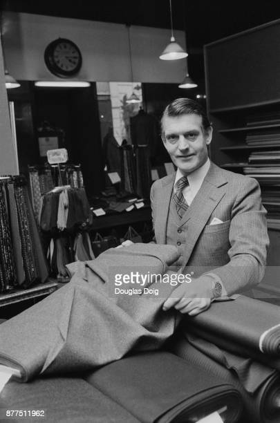 Henry Poole & Co's owner Angus Cundey showing fabrics, London, UK, 25th October 1978.
