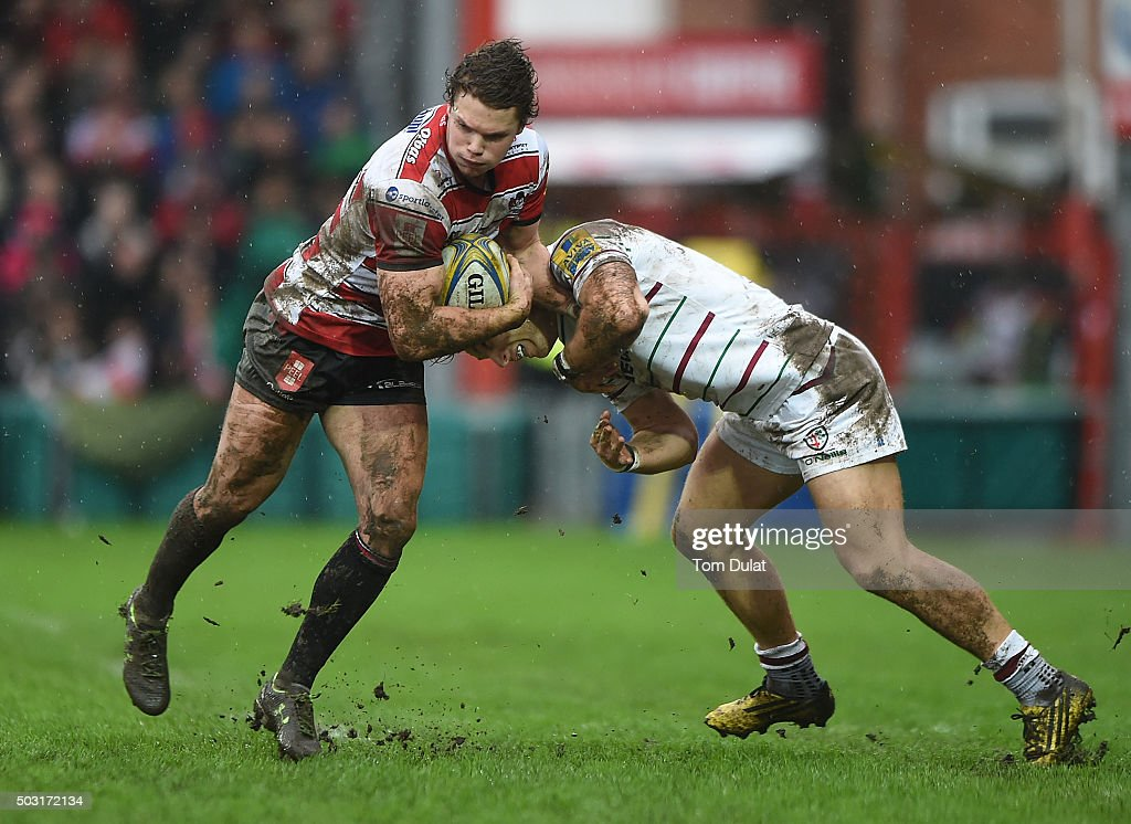 Henry Purdy of Gloucester Rugby is tackled by Alex Lewington of London Irish during the Aviva Premiership match between Gloucester Rugby and London Irish at Kingsholm Stadium on January 2, 2016 in Gloucester, England. (Photo by Tom Dulat/Getty Images).