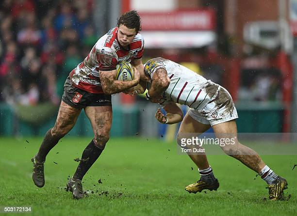 Henry Purdy of Gloucester Rugby is tackled by Alex Lewington of London Irish during the Aviva Premiership match between Gloucester Rugby and London...