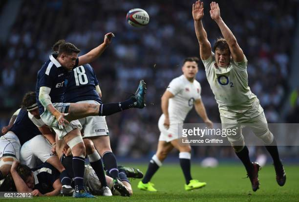 Henry Pyrgos of Scotland kicks the ball away as Joe Launchbury of England attempts to block during the RBS Six Nations match between England and...