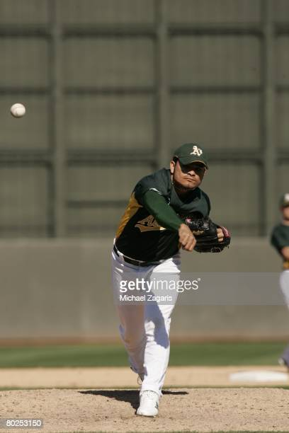 Henry Rodriguez of the Oakland Athletics pitches during the MLB game against the Colorado Rockies at Phoenix Municipal Stadium on March 2 2008 in...