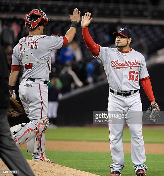 Henry Rodriguez of the Washington Nationals is congratulated by Wilson Ramos after the Nationals beat the San Diego Padres 31 in a baseball game at...