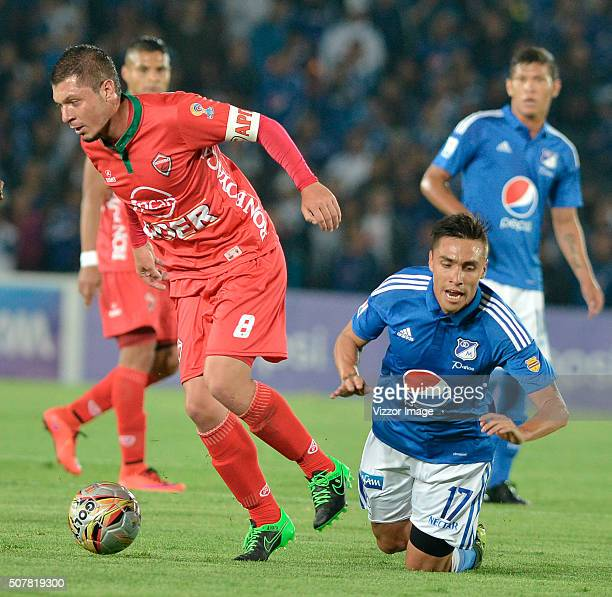 Henry Rojas of Millonarios fights for the ball with Leonardo Pico of Patriotas FC during a match between Millonarios and Patriotas FC as part of the...
