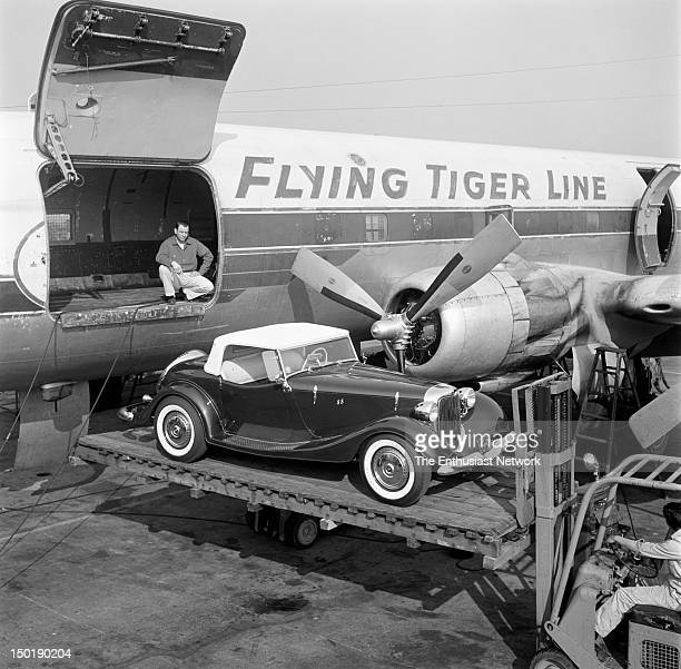 Henry Rootlieb 1933 Ford Custom Roadster being loaded into Flying Tigers cargo plane at LAX for flight to Detroit. The Rootlieb car will be featured...