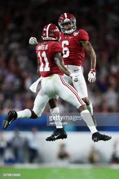 Henry Ruggs III and DeVonta Smith of the Alabama Crimson Tide celebrate after the touchdown in the first quarter against the Oklahoma Sooners during...