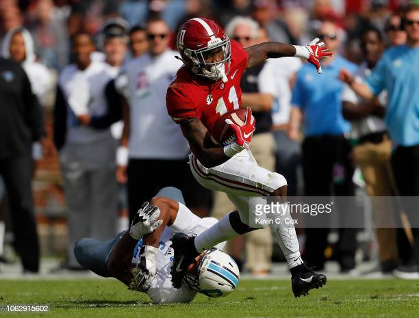 Henry Ruggs III of the Alabama Crimson Tide breaks a tackle by Aaron Brawley of the Citadel Bulldogs at Bryant-Denny Stadium on November 17, 2018 in...