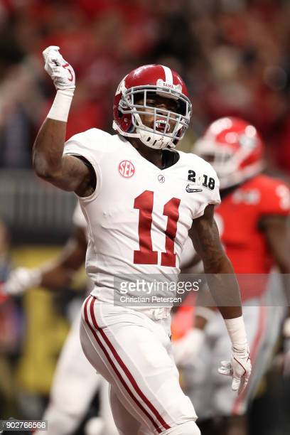 Henry Ruggs III of the Alabama Crimson Tide celebrates a six yard touchdown catch during the third quarter against the Georgia Bulldogs in the CFP...