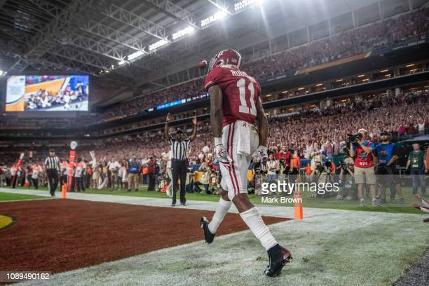 Henry Ruggs III of the Alabama Crimson Tide celebrates a touchdown against the Oklahoma Sooners at the Capital One Orange Bowl at Hard Rock Stadium...