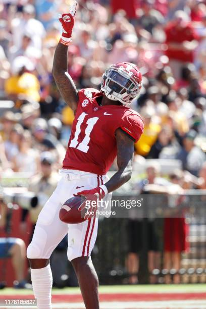 Henry Ruggs III of the Alabama Crimson Tide celebrates after a 45-yard touchdown reception in the first quarter against the Southern Mississippi...