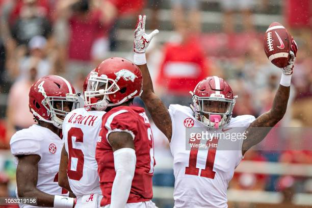 Henry Ruggs III of the Alabama Crimson Tide celebrates after recovering a fumble in the end zone for a touchdown in the first quarter of a game...
