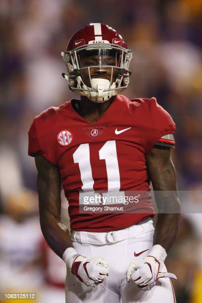 Henry Ruggs III of the Alabama Crimson Tide celebrates his touchdown in the first quarter of their game against the LSU Tigers at Tiger Stadium on...