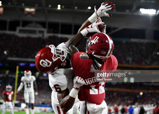 Henry Ruggs III of the Alabama Crimson Tide completes the pass for a touchdown in the defense of Tre Brown of the Oklahoma Sooners during the College...