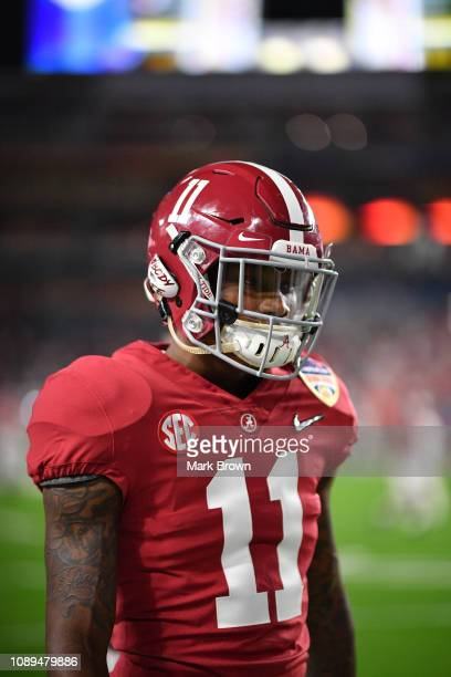 Henry Ruggs III of the Alabama Crimson Tide in action against the Oklahoma Sooners at the Capital One Orange Bowl at Hard Rock Stadium at Hard Rock...