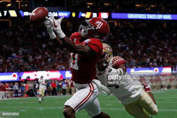 Henry Ruggs III of the Alabama Crimson Tide is unable to make a catch against Tarvarus McFadden of the Florida State Seminoles during their game at...