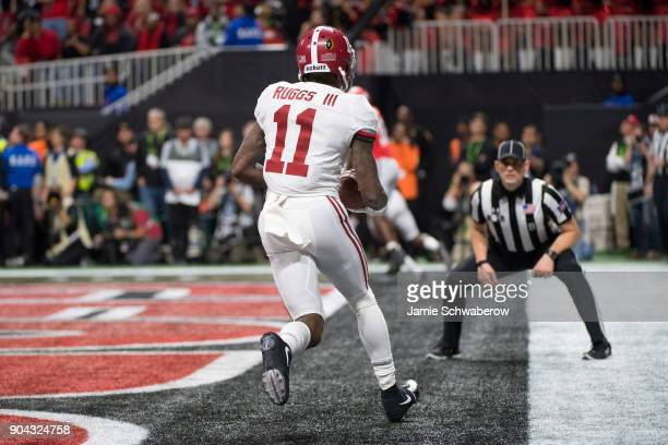 Henry Ruggs III of the Alabama Crimson Tide makes a touchdown reception against the Georgia Bulldogs during the College Football Playoff National...