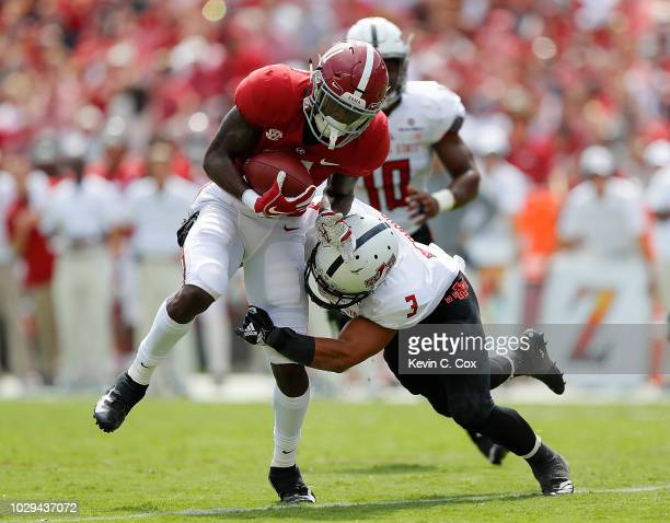 Henry Ruggs III of the Alabama Crimson Tide pulls in this reception and breaks a tackle by BJ Edmonds of the Arkansas State Red Wolves on the way for...