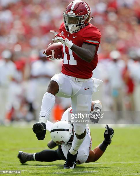Henry Ruggs III of the Alabama Crimson Tide pulls in this reception and breaks a tackle by B.J. Edmonds of the Arkansas State Red Wolves on the way...