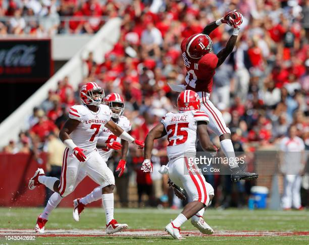 Henry Ruggs III of the Alabama Crimson Tide pulls in this reception against Deuce Wallace, Ferrod Gardner and Corey Turner of the Louisiana Ragin...