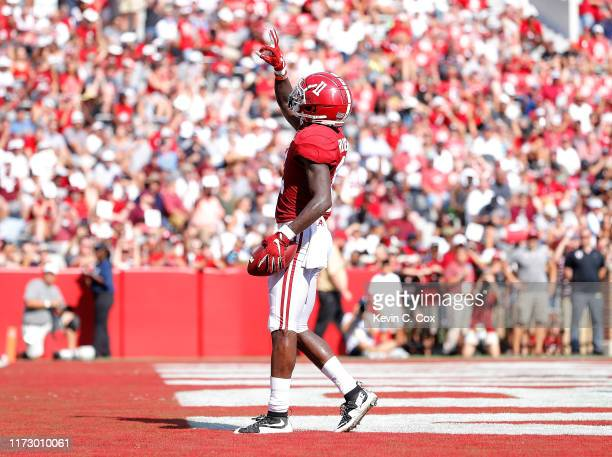 Henry Ruggs III of the Alabama Crimson Tide reacts after this touchdown reception against the New Mexico State Aggies at Bryant-Denny Stadium on...
