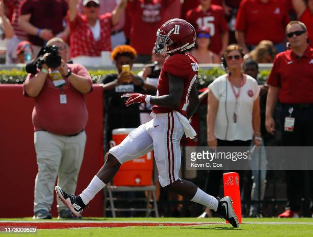 Henry Ruggs III of the Alabama Crimson Tide rushes for a touchdown on the opening play against New Mexico State Aggies at BryantDenny Stadium on...