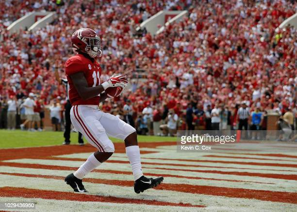 Henry Ruggs III of the Alabama Crimson Tide scores a touchdown against the Arkansas State Red Wolves at BryantDenny Stadium on September 8 2018 in...