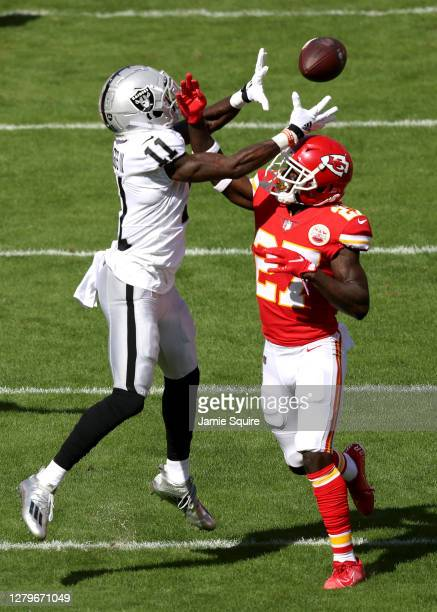 Henry Ruggs III of the Las Vegas Raiders catches a 46-yard pass against Rashad Fenton of the Kansas City Chiefs during the first quarter at Arrowhead...
