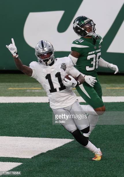 Henry Ruggs III of the Las Vegas Raiders reacts after scoring a touchdown in the final seconds of the second half as Lamar Jackson of the New York...