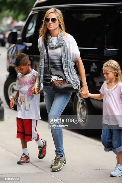 Henry Samuel, Heidi Klum, and Leni Samuel enter a Tribeca hotel on June 17, 2011 in New York City.