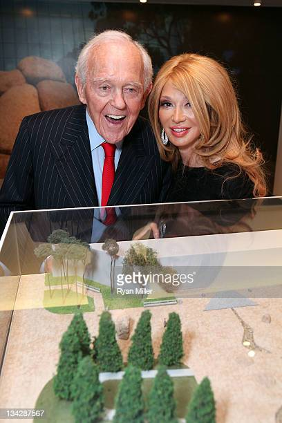 Henry Segerstrom and Elizabeth Segerstrom look over the art during the reception for On Display in Orange County Modern Contemporary Sculpture at The...