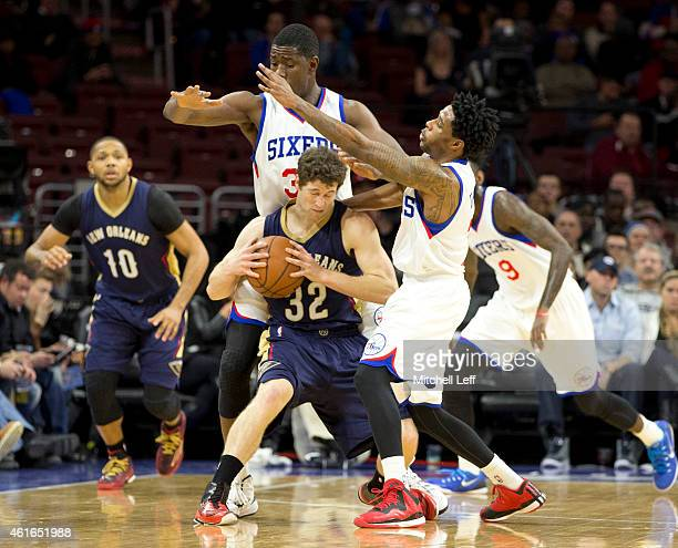 Henry Sims and Larry Drew II of the Philadelphia 76ers guard Jimmer Fredette of the New Orleans Pelicans on January 16 2015 at the Wells Fargo Center...