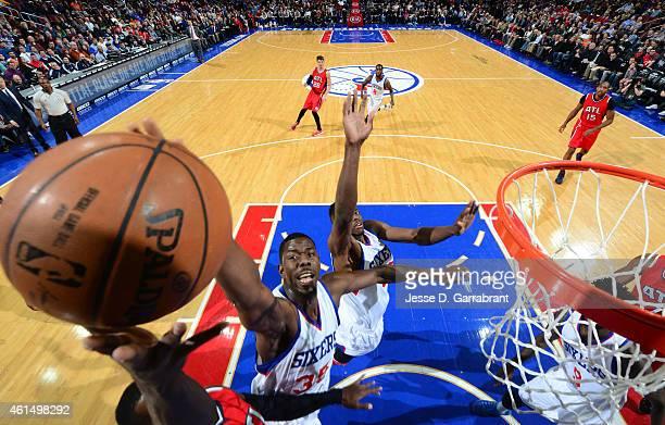 Henry Sims of the Philadelphia 76ers blocks the shot against the Atlanta Hawks at Wells Fargo Center on January 13 2015 in Philadelphia Pennsylvania...