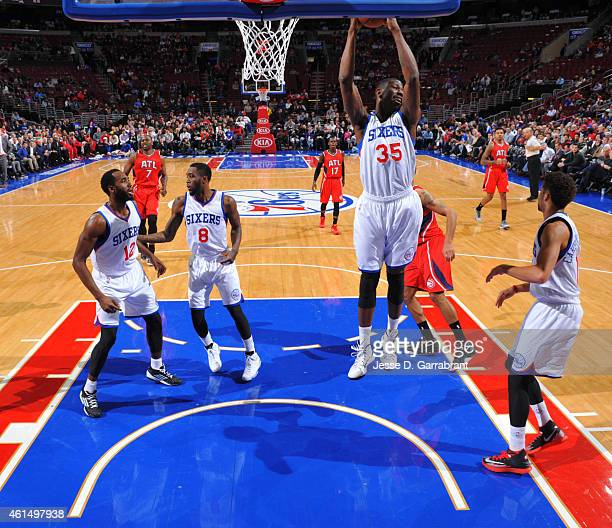 Henry Sims of the Philadelphia 76ers grabs the rebound against the Atlanta Hawks at Wells Fargo Center on January 13 2015 in Philadelphia...