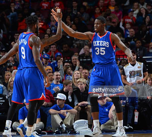 Henry Sims of the Philadelphia 76ers greets his teammates against the Indiana Pacers at Wells Fargo Center on January 10 2015 in Philadelphia...