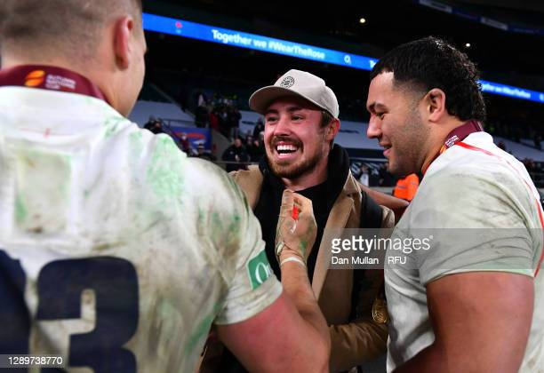 Henry Slade and Ellis Genge of England celebrate with Jack Nowell after victory in the Autumn Nations Cup Final & Quilter International between...