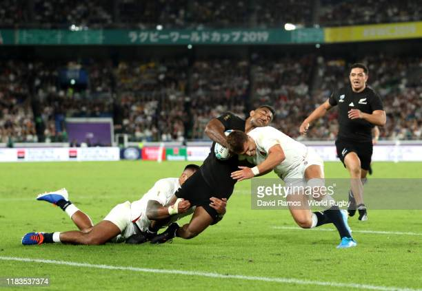Henry Slade and Manu Tuilagi of England tackle Sevu Reece of New Zealand during the Rugby World Cup 2019 SemiFinal match between England and New...