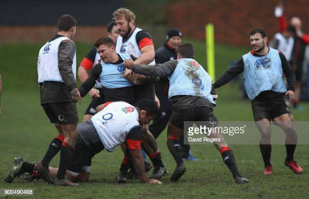 Henry Slade is tackled during the England training session at Brighton College on January 2 2018 in Brighton England
