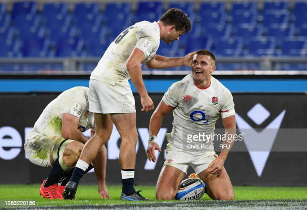 Henry Slade of England celebrates scoring his sides fifth try with George Furbank of England during the 2020 Guinness Six Nations match between Italy...