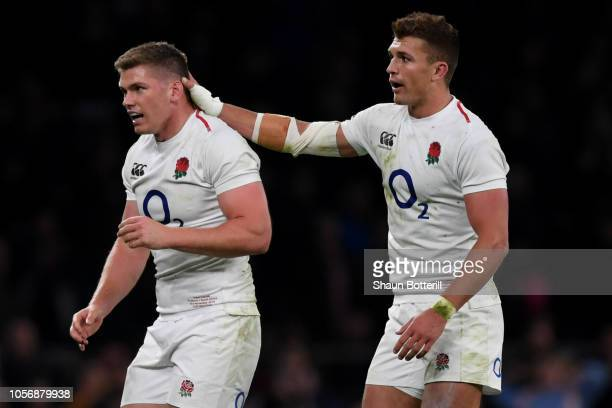 Henry Slade of England celebrates victory with team mate Owen Farrell following the Quilter International match between England and South Africa at...