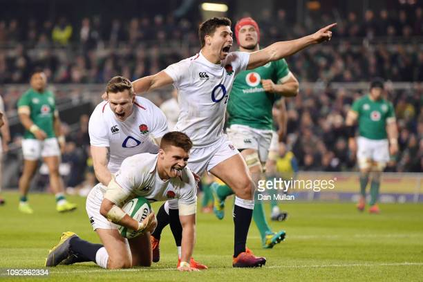 Henry Slade of England celebrates with teammates as he crosses to score their side's fourth try during the Guinness Six Nations between Ireland and...