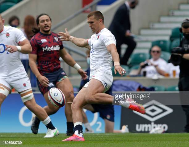 Henry Slade of England clears the ball during the Summer International match between England and USA at Twickenham Stadium on July 4, 2021 in London,...