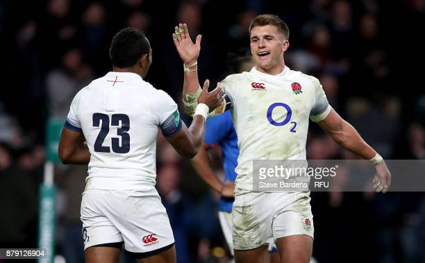 Henry Slade of England congratulates Semesa Rokoduguni after he scored his team's seventh try during the Old Mutual Wealth Series match between...