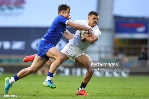 Henry Slade of England hands off Damian Penaud of France during the Guinness Six Nations match between England and France at Twickenham Stadium on...