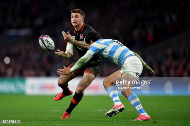 Henry Slade of England looks to offload as he is tackled during the Old Mutual Wealth Series match between England and Argentina at Twickenham...