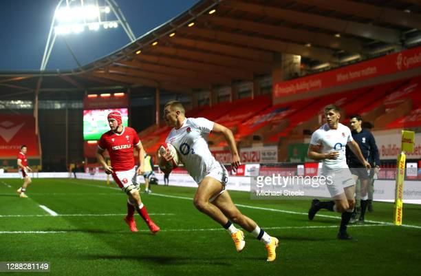 Henry Slade of England runs in to score their first try during the Autumn Nations Cup match between Wales and England at Parc y Scarlets on November...