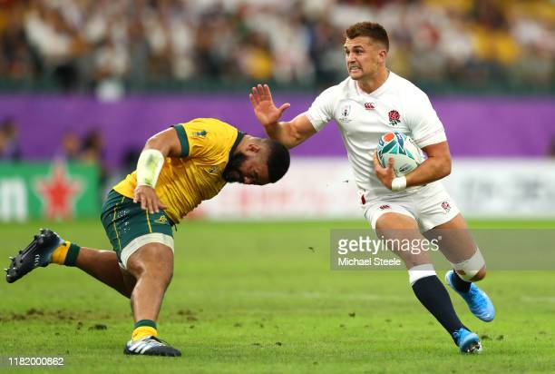 Henry Slade of England runs with the ball under pressure by Tolu Latu of Australia during the Rugby World Cup 2019 Quarter Final match between...