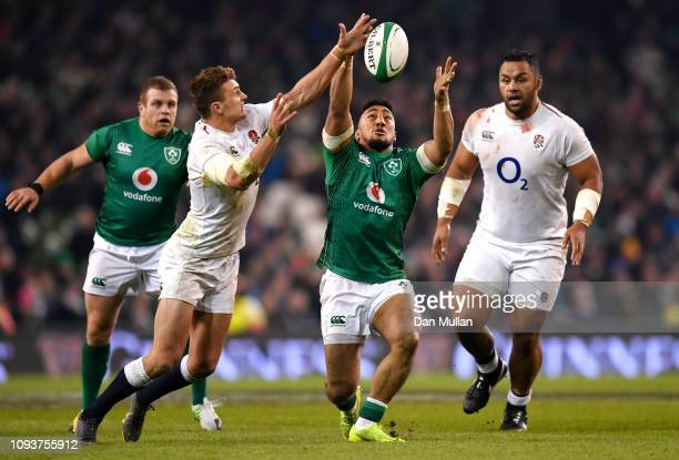Henry Slade of England steals the ball from Bundee Aki of Ireland during the Guinness Six Nations between Ireland and England at Aviva Stadium on...