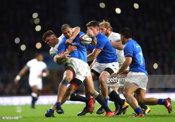 Henry Slade of England tackles Paul Perez of Samoa duirng the Old Mutual Wealth Series between England and Samoa at Twickenham Stadium on November 25...