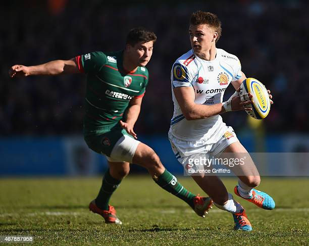 Henry Slade of Exeter Chiefs avoids Ben Youngs of Leicester Tigers during the Aviva Premiership match between Leicester Tigers and Exeter Chiefs at...