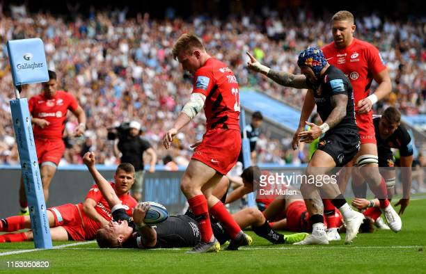 Henry Slade of Exeter Chiefs celebrates after touching down for his team's fourth try during the Gallagher Premiership Rugby Final between Exeter...